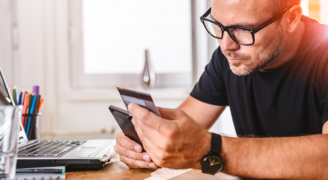 Man checking account on cell phone