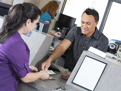 Customer at the bank getting money from teller