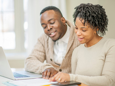 African American couple reviewing the paperwork on their new home.
