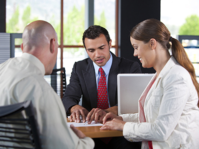 Husband and wife meeting with bank representative