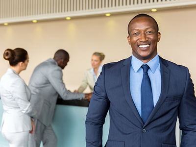 African businessman standing at hotel reception