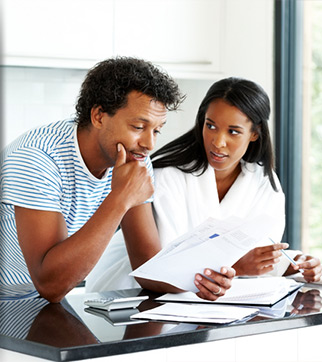 Couple looking over bank statement together