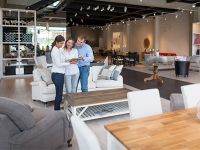 Interior designer with couple, helping them pick out new furniture.