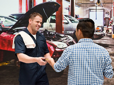 Mechanic taking payment from customer.