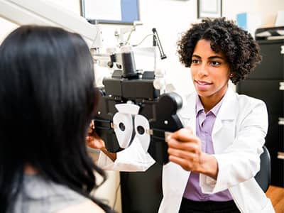 Female optometrist with patient.