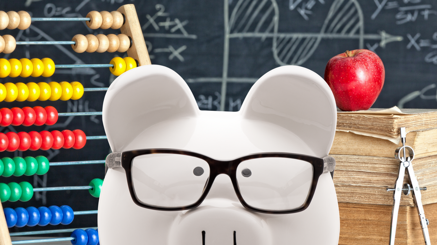 Piggy bank with glasses on in a classroom setting